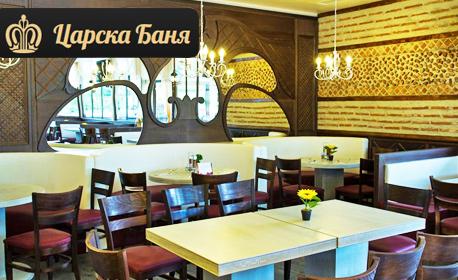 Релакс в град Баня! Нощувка със закуска и вечеря, плюс релакс зона, процедура по избор и топъл външен басейн