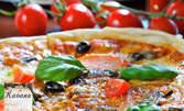 Голяма пица по избор, или пилешка пържола филе, плюс салата
