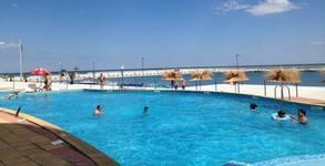 Почивка в Поморие през Юли! 3, 4 или 5 нощувки със закуски, плюс басейн с морска водa и процедури