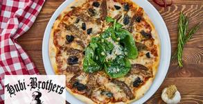 Вкусна пица по избор, приготвена с тесто от италианско брашно и естествена закваска