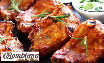 1.1кг апетитно хапване в Colombiana Pizza Bar Dinner! Свински ребърца, пилешки жулуени, уеджис картофки и гриловани зеленчуци