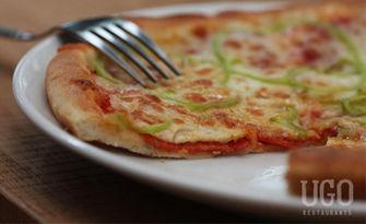 Апетитно хапване! 2 големи пици по избор, от UGO restaurants