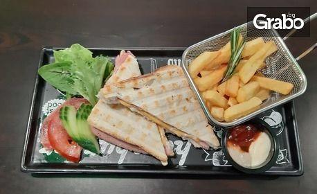2 броя клуб сандвич, тортила или бургер, поднесени с пържени картофки