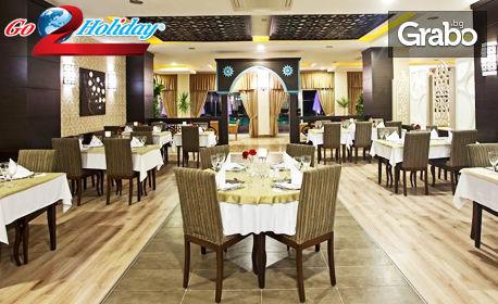 Нова година в Анталия! 4 нощувки на база All Inclusive с празнична вечеря в хотел Titan Select 5*, плюс самолетен транспорт